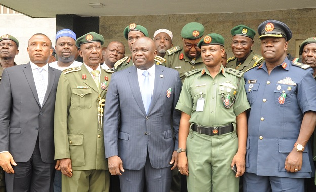 Lagos State Governor, Mr. Akinwunmi Ambode (middle); Secretary to the State Government, Mr. Tunji Bello (left); Chairman, Nigerian Legion, Lagos State Chapter, Col. Samuel Akande, rtd. (2nd left); Commander, 9 Brigade, Nigerian Army Cantoment, Ikeja, Brigadier General Sani Mohammed (2nd right); Commander, 551 Base Service Group, NAF, Ikeja, Air Commodore Paul Masiyer (right) and members of the Nigerian Legion during the launching of the Y2017 Armed Forces Remembrance Emblem Appeal at the Lagos House, Ikeja, on Monday, December 19, 2016.