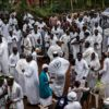 Militants of the Indigenous People of Biafra (IPOB), members of the Yahveh Yashua Synagogue (Yisraelities Biafra Region) celebrate Shabbat outside the residence of the movement's leader Nnamdi Kanu in Umuahia, on May 27, 2017. / AFP PHOTO / MARCO LONGARI