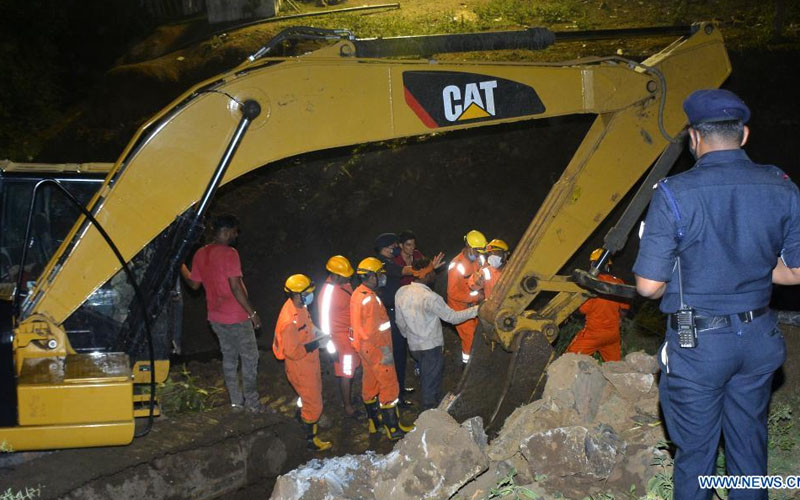 Rescuers are in operation after people fell into a well at Ganj Basoda area of Vidisha district, about 120 km from Bhopal, the capital city of India's Madhya Pradesh state, July 16, 2021. Rescuers have pulled out 11 bodies and rescued 19 people from a well after a concrete slab over it collapsed in the central Indian state of Madhya Pradesh, police said Saturday. The people had assembled on the slab of the well to rescue a child from drowning. (Str/Xinhua)